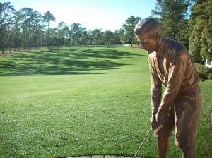 bronze bust of Bobby Jones behind clubhouse